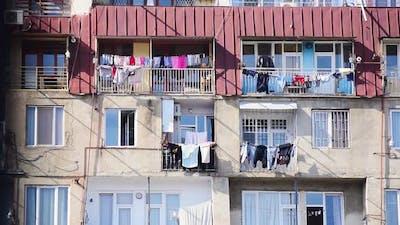 Caucasus Block House In Summer With Hanging Clothes.Caucasus Culture