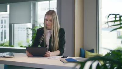 Stylish Business Woman with Tablet in Office