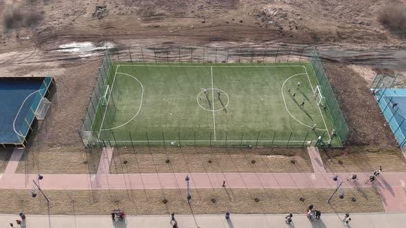 People play football