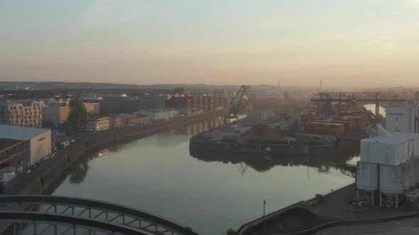 Thumbnail for Cargo Port Area on River in Early Morning Haze, No Traffic in Frankfurt Am Main, Germany