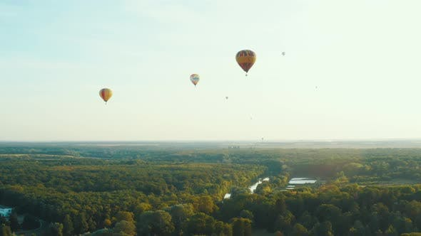 Thumbnail for Aerial Scene of Hot Air Balloons Flying Over the Forest. Summer Sunset