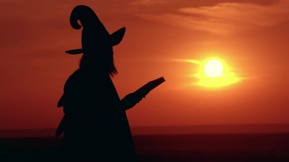Thumbnail for Girl in Fancy Dress and Hat Witch Holds Book Sunrise View