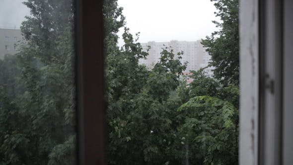 Thumbnail for Heavy Rain Focus Pulling From Window To Building
