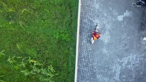 Aerial drone view of a man riding his motocross motorcycle