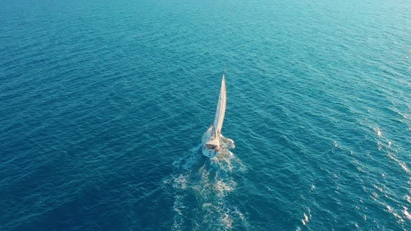 Thumbnail for Aerial View. Yacht Sailing on Open Sea at Sunny Day. Sailing Boat in Sea