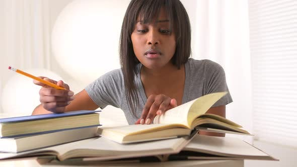 Thumbnail for Black woman college student studying for finals