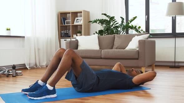 Thumbnail for Indian Man Making Abdominal Exercises at Home