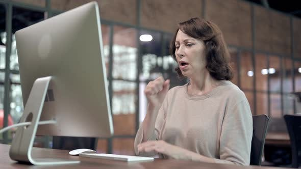 Thumbnail for Sick Old Woman Coughing While Working on Computer