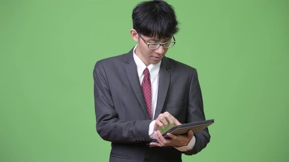 Thumbnail for Young Asian Businessman Using Digital Tablet