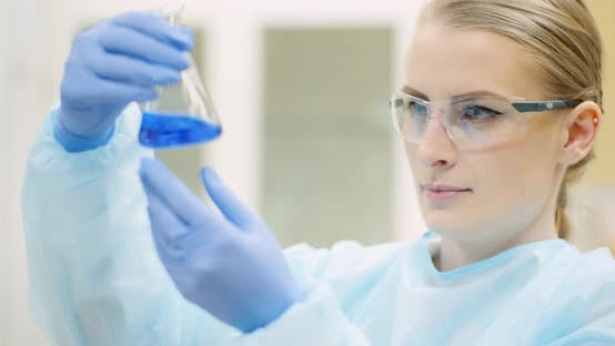 Thumbnail for Female Scientist with a Pipette Analyzes a Liquid at Laboratory