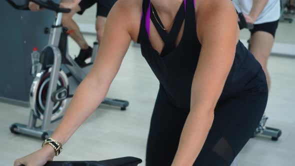 Thumbnail for Fit Woman Spinning Indoor Bike at Cycling Class. Portrait Sportive Woman on Bicycle Training in Gym