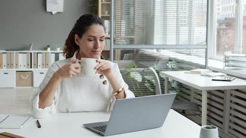 Woman Sitting at Workplace