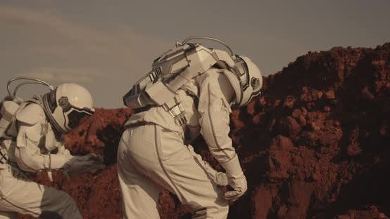 Thumbnail for Astronaut Examining Rock on Mars