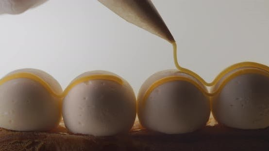 Thumbnail for Confectioner Adds Salty Caramel To the Cheese Balls on the Eclair, Making Dessert with Mascarpone