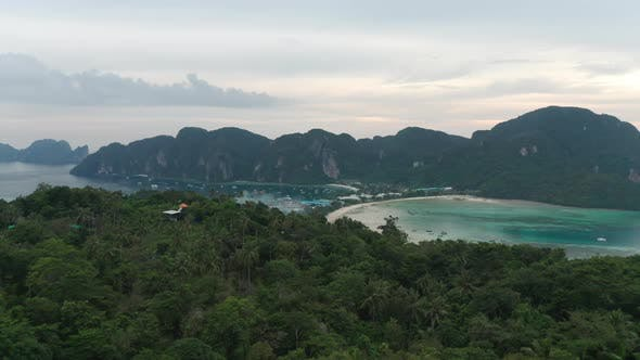 Majestic Ocean Waters White Sandy Beach and Forest Trees in Thailand