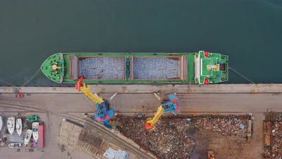 Drone View Vertically Down to the Cargo Crane Loading the Dry Cargo Ship