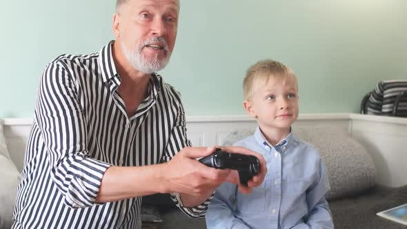 Thumbnail for Emotional Grandfather Plays with His Grandson in Computer Games with a Joystick
