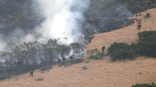 Firefighters hiking up mountainside during wildfire in Utah