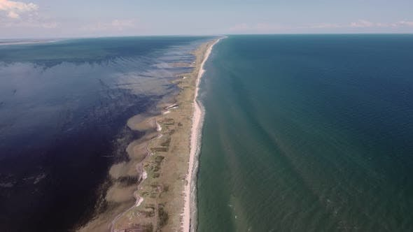Thumbnail for Aerial Shot of a Boundless Limestone Sandspit on the Black Sea in Summer