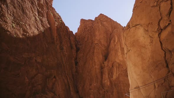 Sandstone Rocks Wall Of Gorge With Bright Sunlight