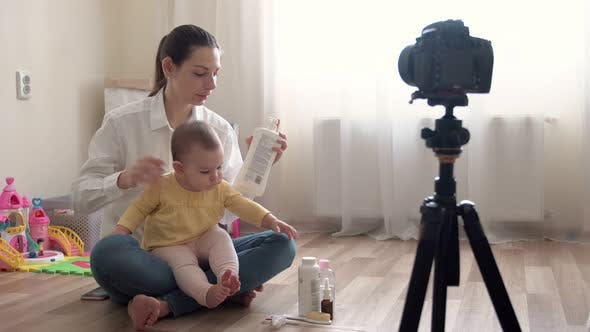 Young Mother with Little Boy Recording Video on Camera and Vlogging About Family and Childhood