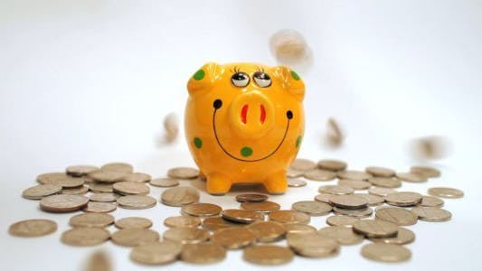 Thumbnail for Dollar Coins Falling on Piggy Bank