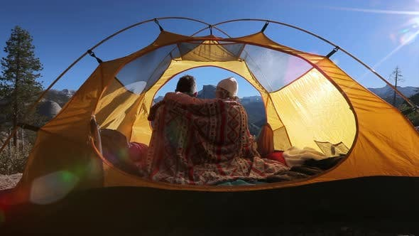 Cover Image for The Couple of Lovers Embracing Inside the Tent at a Dawn in the Yosemite National Park.