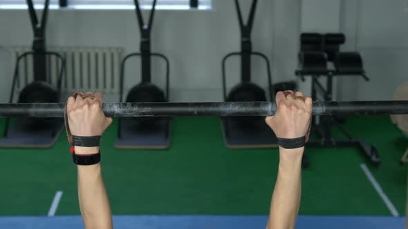 Thumbnail for Athletic Woman Does Pull Ups in the Gym