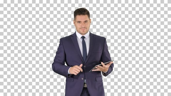 Thumbnail for Businessman Walking and Swiping Pages on His Tablet Computer