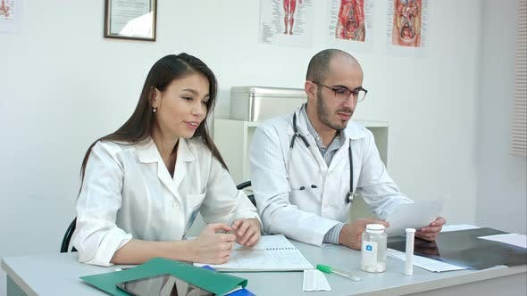 Thumbnail for Pretty Nurse and Male Doctor Talking To the Patient
