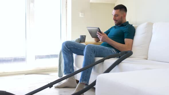 Thumbnail for Man with Tablet Pc and Vacuum Cleaner at Home