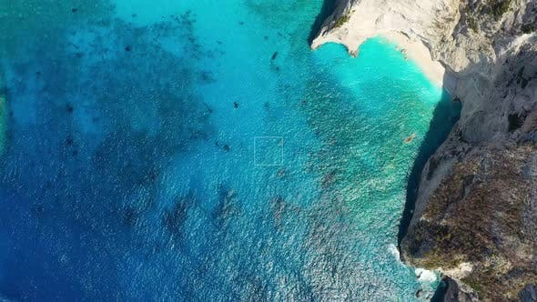 Aerial seascape at the day time. Bay and rocks. Blue water background in the summer.