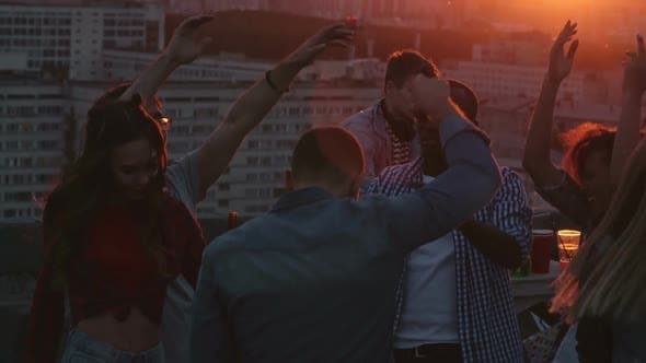 Cover Image for Diverse Young Friends Partying on Rooftop