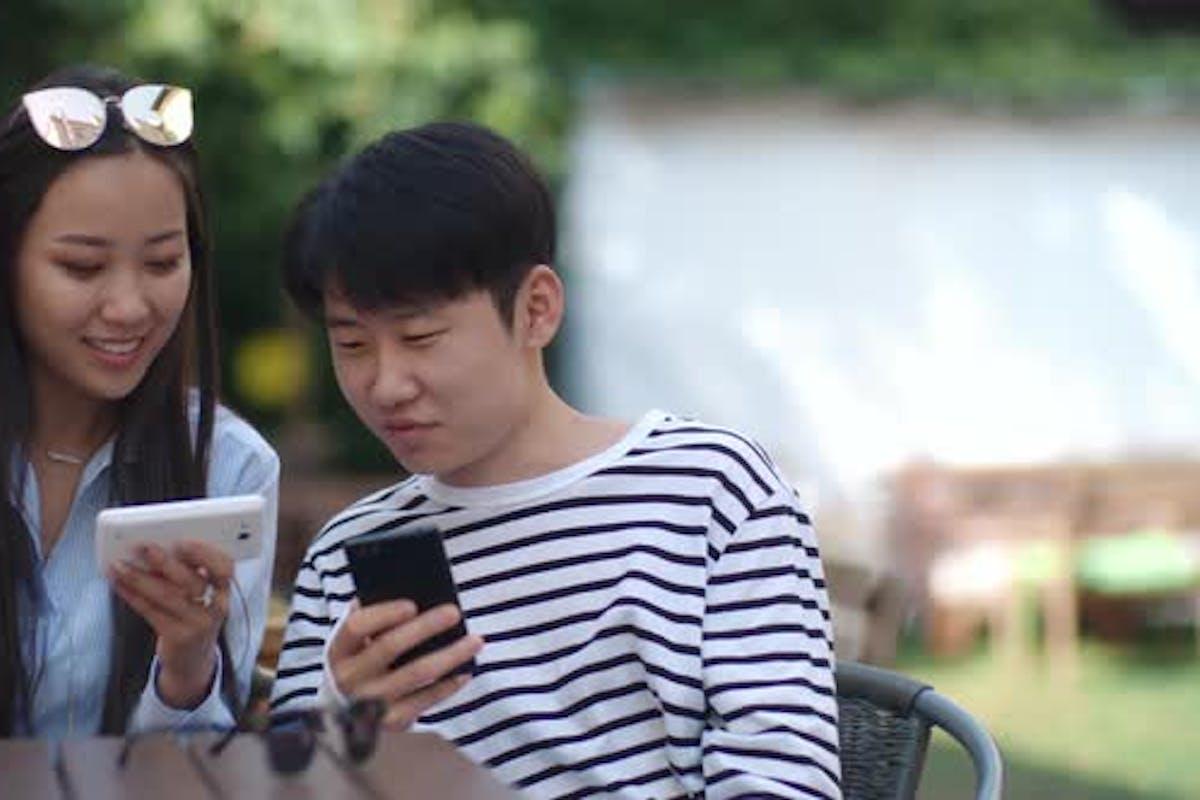 Happy Asian Teens Having Refreshing Drinks And Taking Photo ... | 800x1200