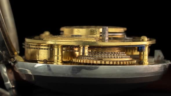 Thumbnail for Working Mechanism of a Vintage Watch Close Up . Black Background. Time Lapse