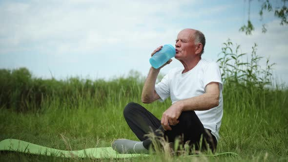 Thumbnail for Lifestyle, Healthy Elderly Man Drinks Clean Cool Water From Bottle for Sports Nutrition After