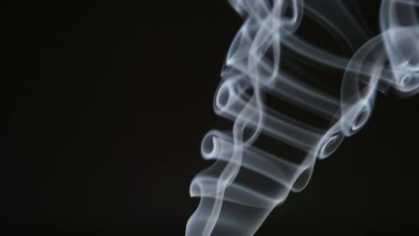 Smoke curves on a black background