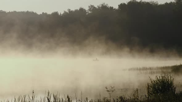 Thumbnail for Man Fishing At Misty Lake