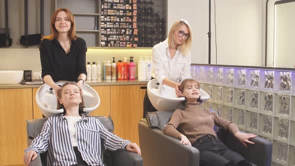 Professional Hairdresser in Beauty Saloon with Clients