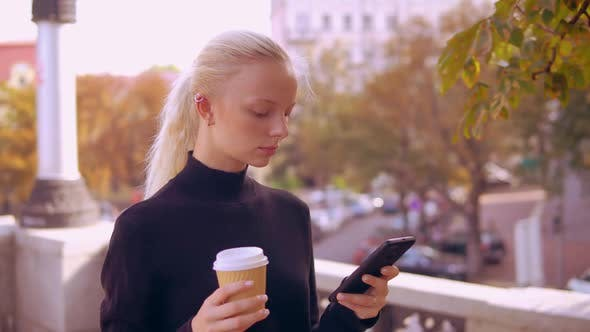 Thumbnail for Portrait Blonde Use Phone in Town