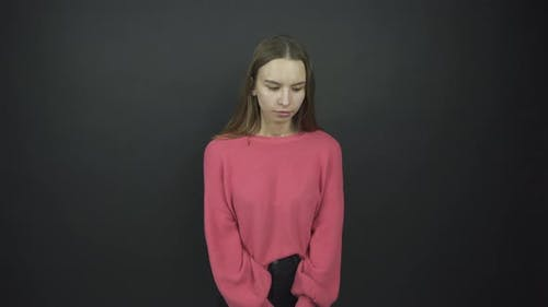 Actress in Purple Pullover Performs Confusion Emotion