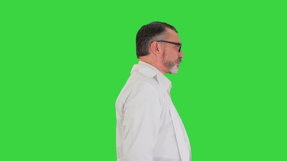 Mature Doctor Physician Walking Isolated on a Green Screen Chroma Key