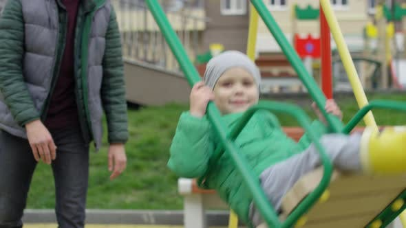 Thumbnail for Happy Caucasian Boy Riding on Swing and Dad Pushing