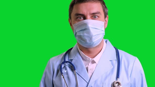 Young Doctor Stand and Looking Into Camera on Green Chroma Key Background