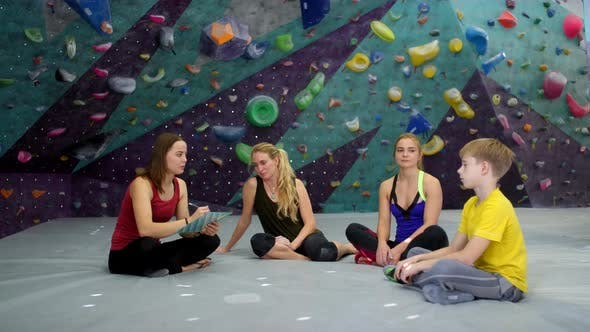 Thumbnail for Female Climbing Coach Giving Instructions to Trainees