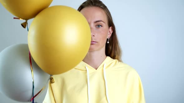 Thumbnail for Portrait of a Sad Woman at a Party. Upset Girl on a Holiday with Balloons