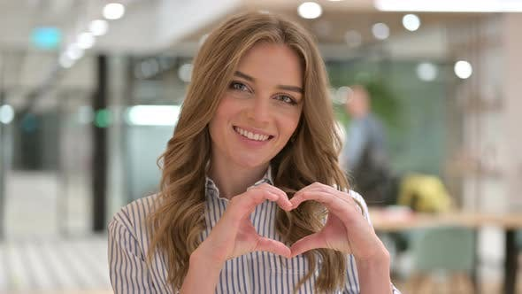 Portrait of Businesswoman Showing Heart Sign with Hand