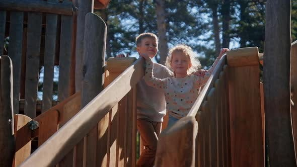 Thumbnail for Children Hugs at Country Playground Wooden Slide