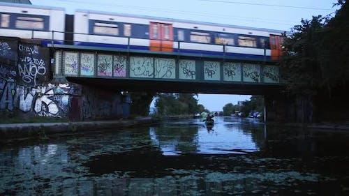 Kayaking Under Train Bridge in Central London - Blue Hour Evening View