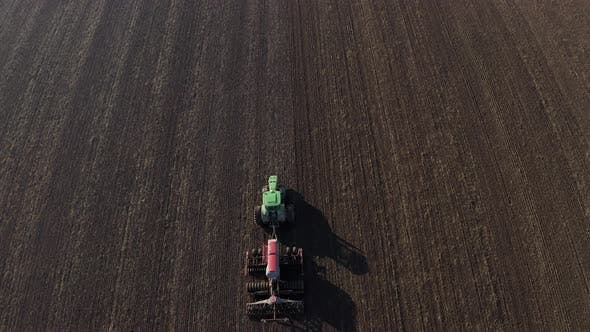 Thumbnail for Aerial View Of Harvest Fields. Tractor Driving Across The Field.